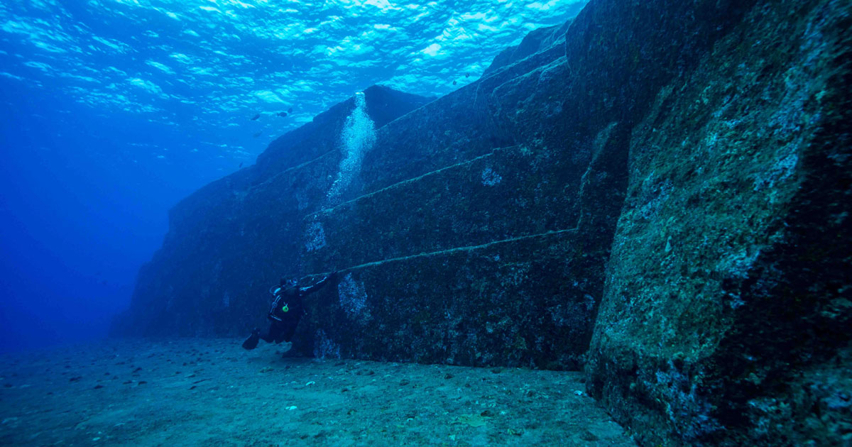 Steps with diver for scale at Yonaguni Monument diving Okinawa Japan Diveplanit
