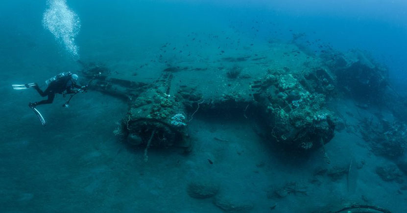 Craig Taylor diving a B17 wreck in the Solomon Islands. Image (c) Mick Harris