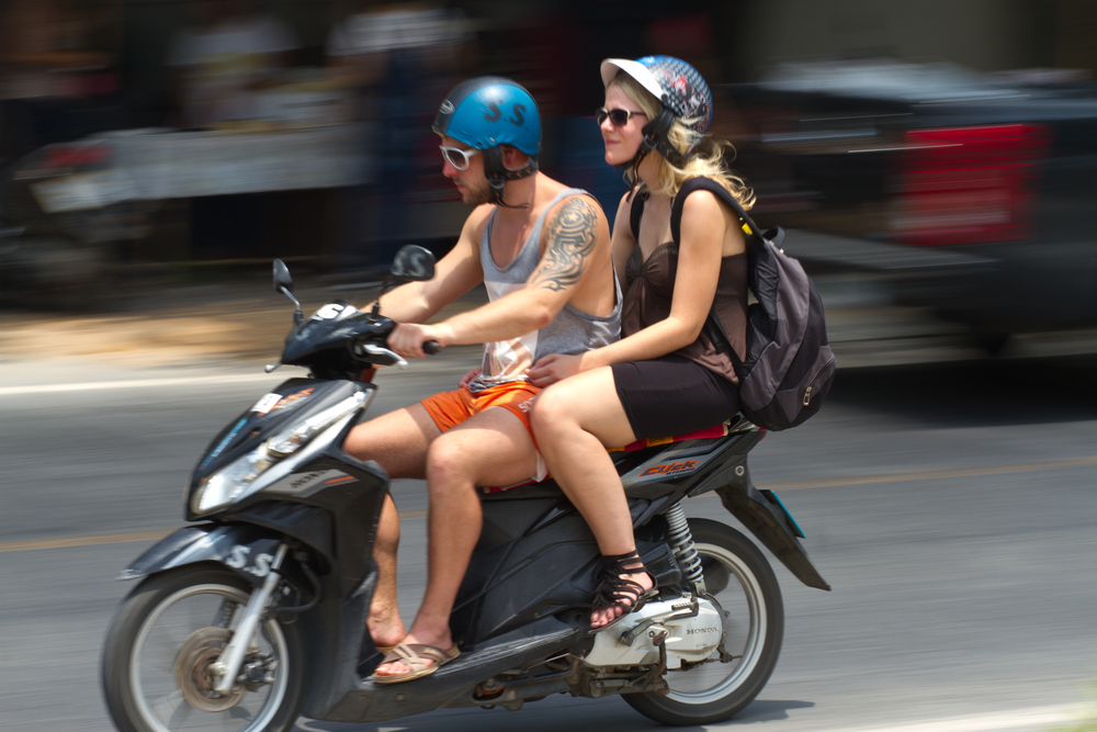 Couple on scooter in Thailand
