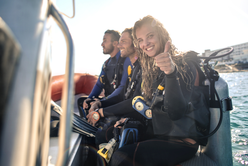 Happy divers on boat
